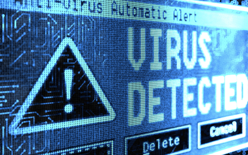 Picture of a computer screen. The computer screen is displaying a blue detected virus symbol.